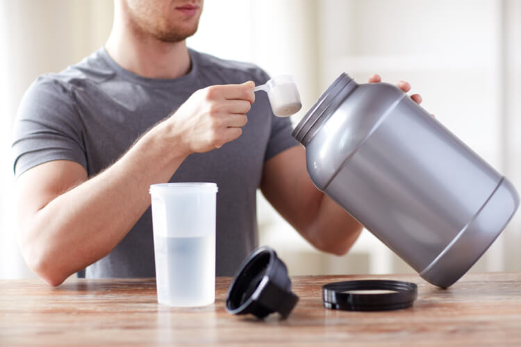 Man about to mix his supplement drink.