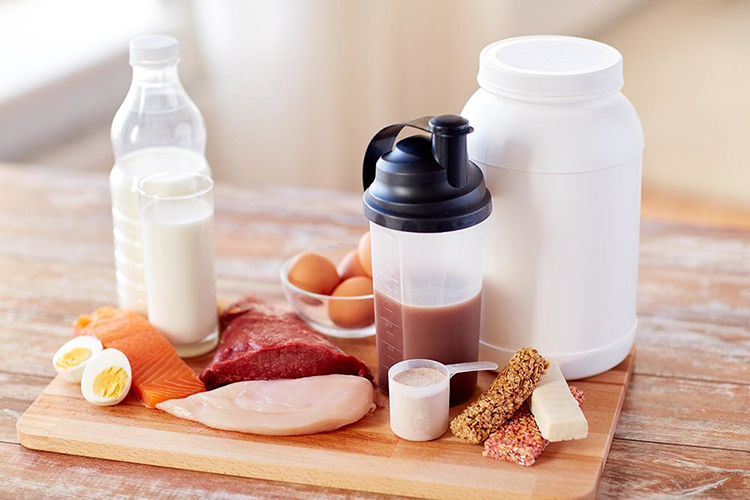 foods high in protein, meat, milk eggs, high protein snack bar on table,
