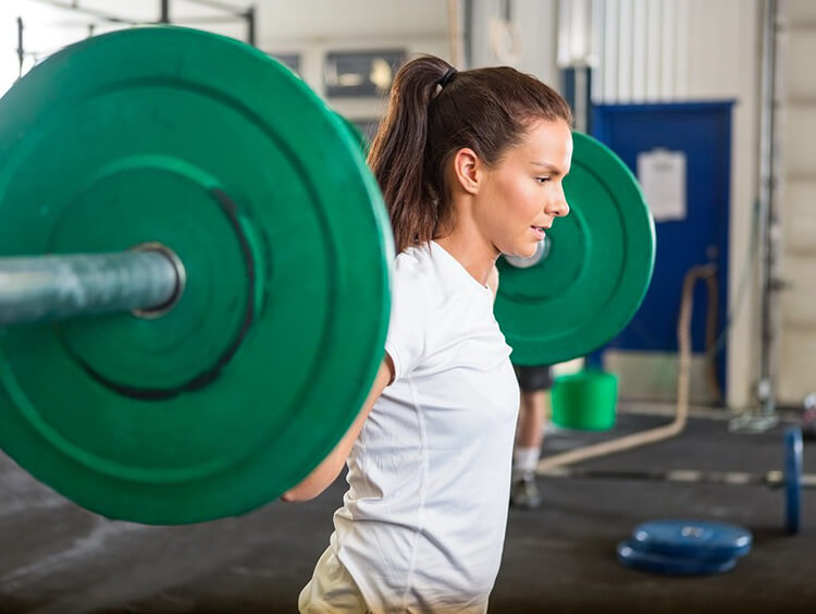 woman lifting green barbell, powerlifting woman 5