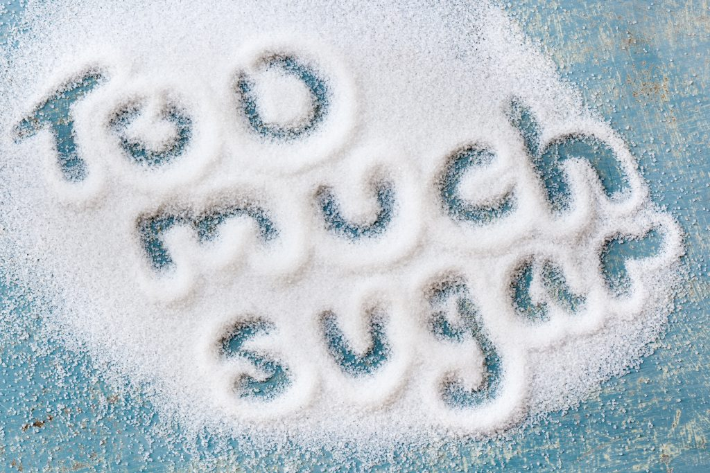 text written on sugar crystals on table, sugar myths