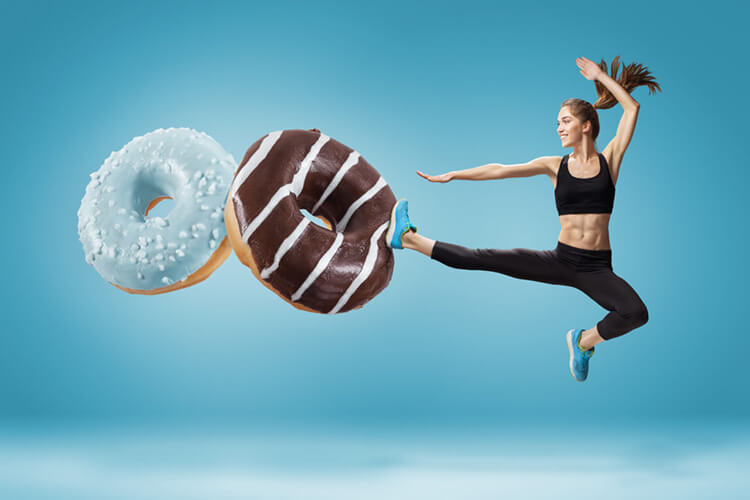 woman kicking 2 giant donuts while wearing sportswear, sugar myths, hyperactive