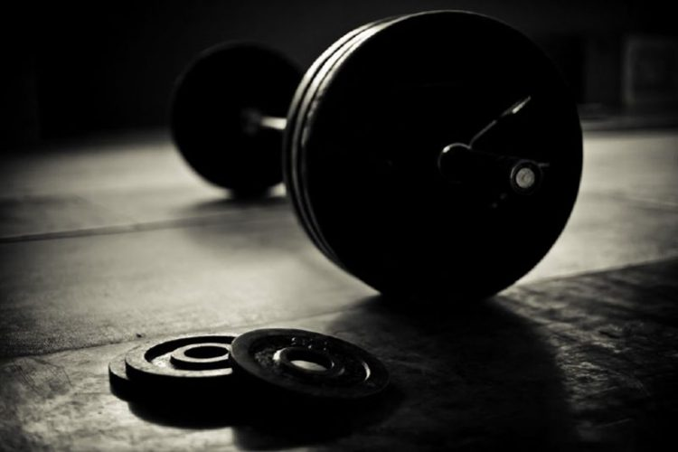 barbell and discs in a weightlifting gym, deadlifts