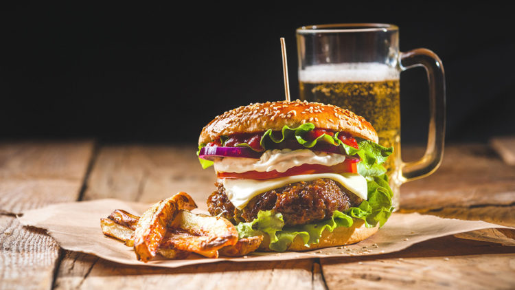 hamburger meal with drinks on table, weight loss