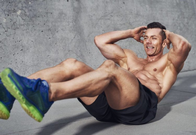 Muscular man doing sit up exercise, weight loss