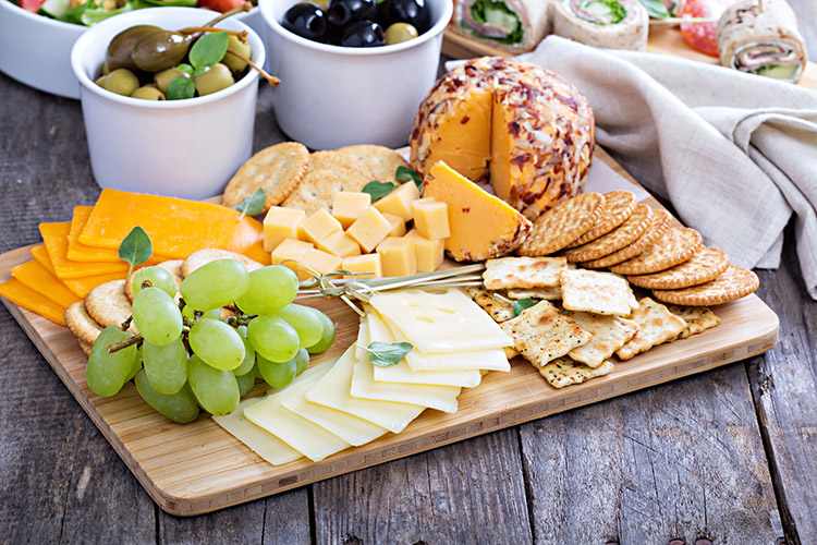 Olives, green grapes, weird cheeses beautifully laid out on the table, biscuitsweight loss