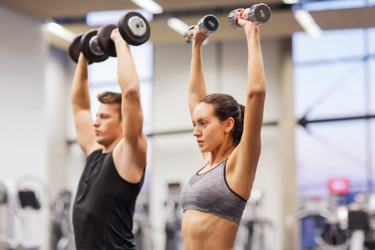 half body shot a man and a woman exercising with dumbbells in a gym, Mentrual cycle