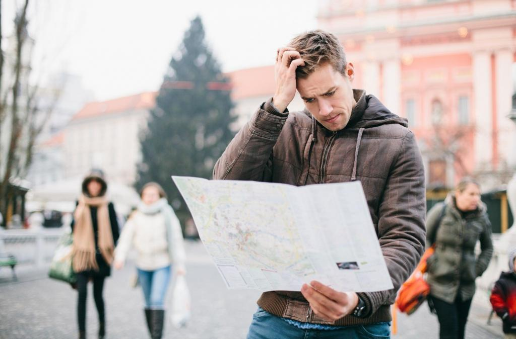 confused man looking at map