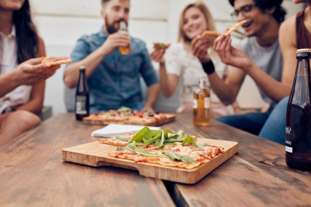 Group of friends enjoying layers of healthy pizza