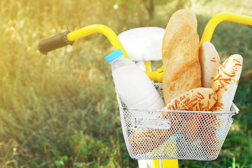 Basket of fresh foodstuffs on bike, outdoors